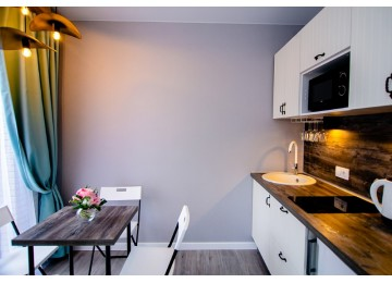 Семейный с балконом 4-местный 2-комнатный (с кухней)