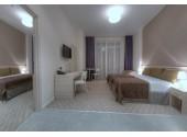 Отель «Спорт Инн» 4-местный 2-комнатный апартамент